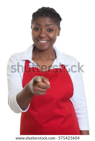 Laughing african american waitress pointing at camera - stock photo