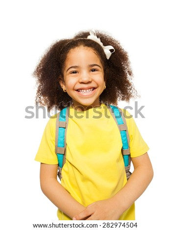 Laughing African girl in yellow T-shirt standing - stock photo
