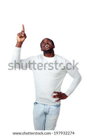 Laughing african man pointing up on white background - stock photo