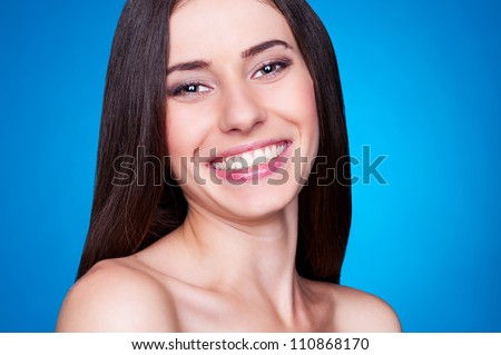 laughing and happy female over blue background - stock photo