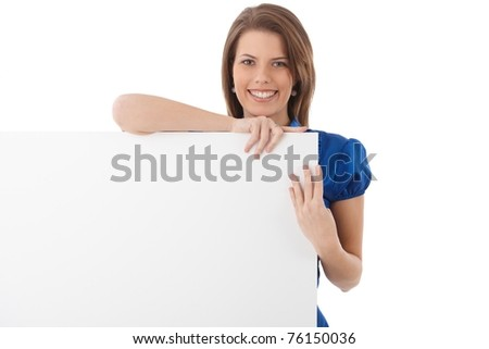 Laughing attractive woman with blank sheet in studio, copyspace.?