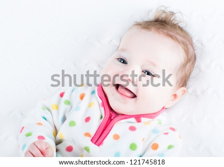 Laughing baby girl showing her tongue - stock photo
