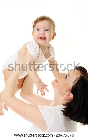 laughing baby playing with mother - stock photo