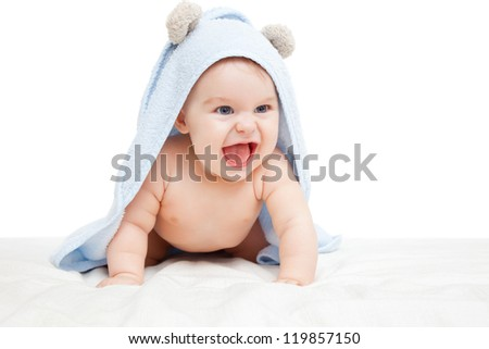 Laughing baby with towel on white - stock photo