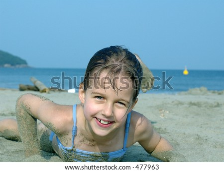 Laughing beautiful girl on the beach