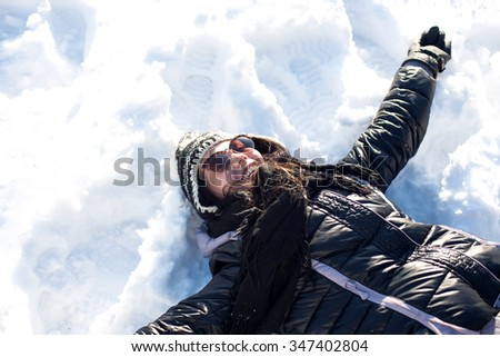 Laughing beautiful girl portrait in winter time with snow - stock photo