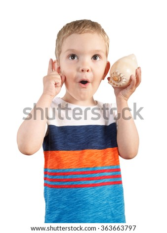 Laughing blond boy listening to seashell. isolated on white