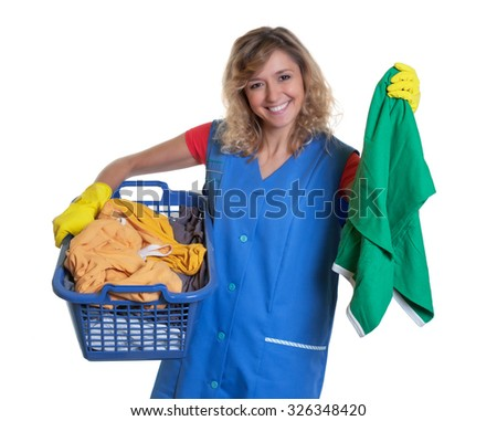 Laughing blonde housewife with dirty clothes - stock photo
