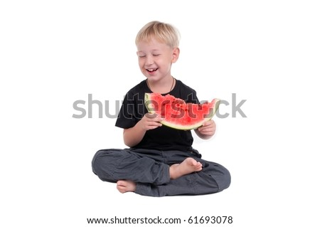 Laughing boy holding  a slice of watermelon