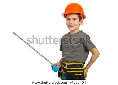 Laughing boy with helmet holding ruler isolated on white background - stock photo