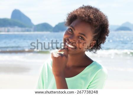 Laughing brazilian woman at Copacabana beach - stock photo