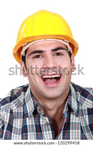 Laughing builder - stock photo