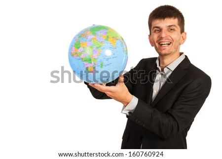 Laughing business man holding world globe isolated on white background