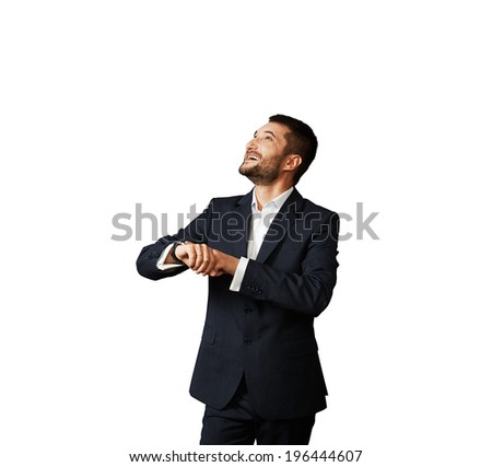 laughing businessman looking up over white background