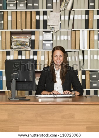 Laughing Businesswoman at the office - stock photo