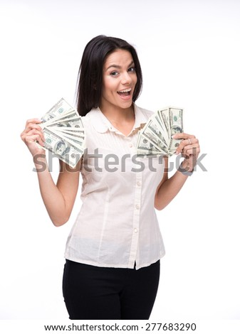 Laughing businesswoman holding US dollar bills over white background and looking at camera - stock photo