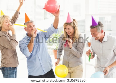 Laughing casual business people celebrating birthday in the office - stock photo