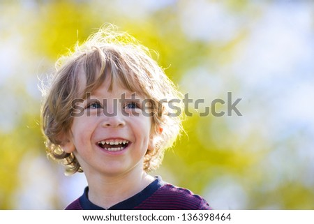 Laughing child in the sun - stock photo