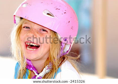Laughing child with a safety helmet - stock photo