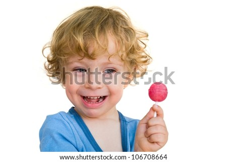 Laughing child with lollipop - stock photo