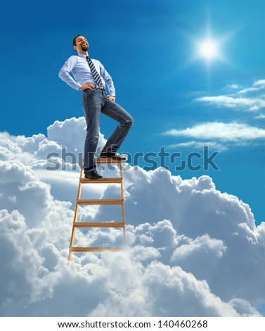 Laughing confident businessman standing at the top of ladder high in the sky  - stock photo