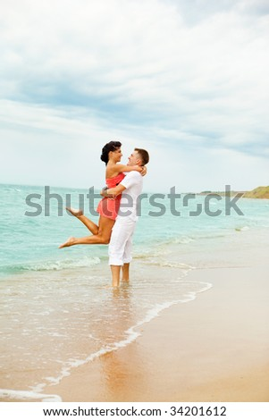 Laughing couple enjoying time together at the beach