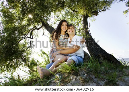 Laughing couple on the island under the tree.