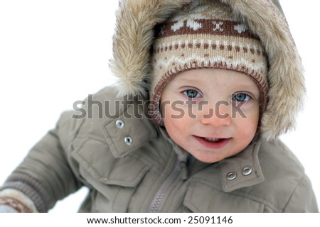 Laughing cute baby boy winter