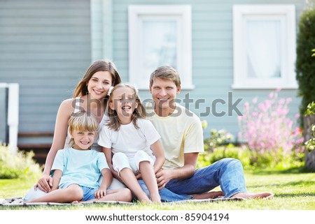 Laughing family with children outdoors - stock photo