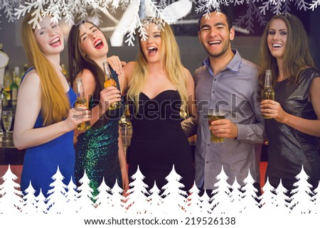 Laughing friends holding beers posing against fir tree forest and snowflakes - stock photo