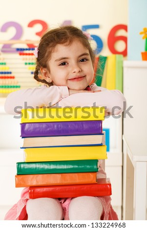 laughing girl with book - stock photo