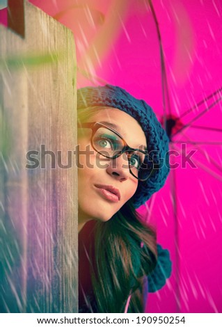 laughing girl with pink umbrella, surprised - stock photo