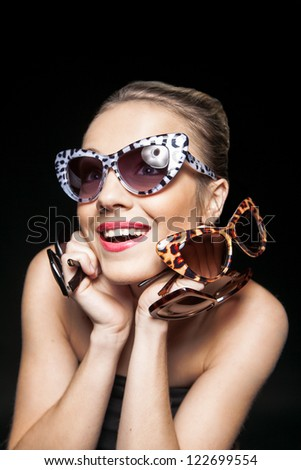 Laughing girl with sunglasses - stock photo