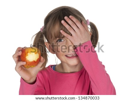 laughing girl with tooth gap eating apple