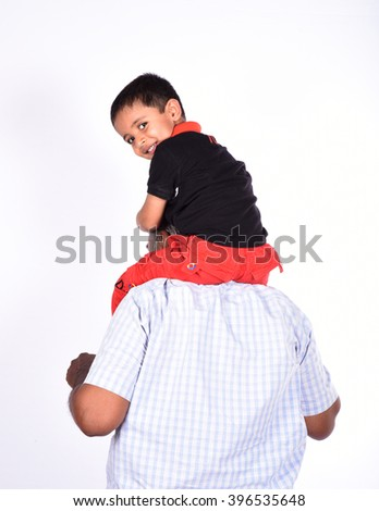 Laughing grandfather with his grandson as they play together  - stock photo