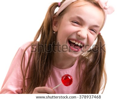 laughing happy little girl with lollipop - stock photo