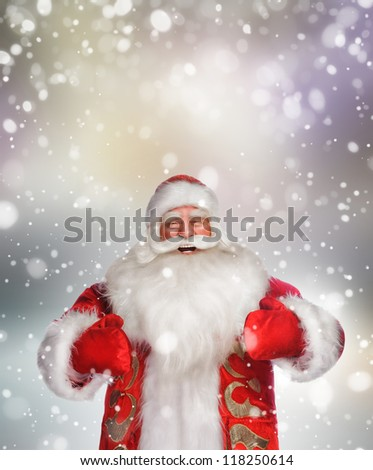 Laughing happy Santa Claus over snowflake background - stock photo