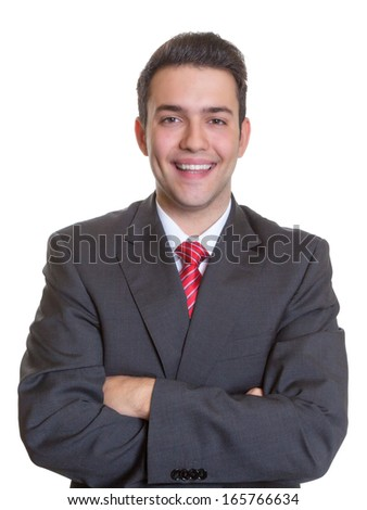 Laughing hispanic businessman with crossed arms
