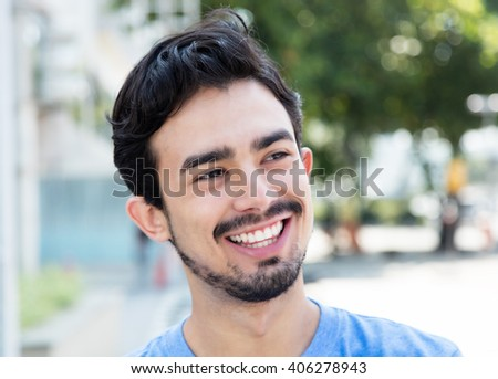 Laughing hispanic guy in the city