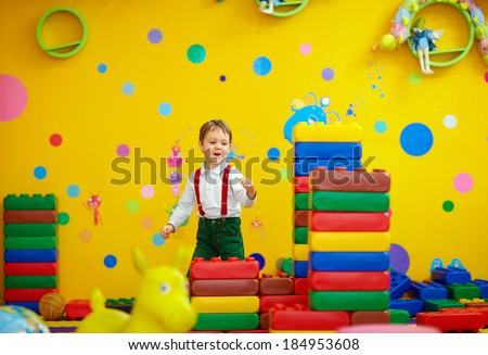 laughing kid having fun in kindergarten - stock photo