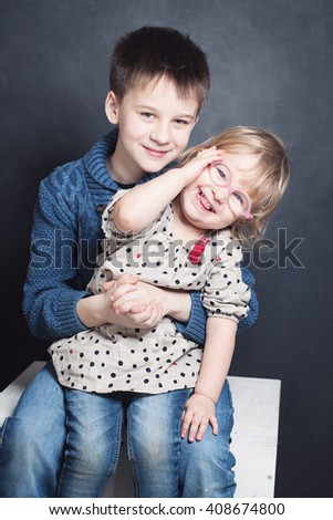 Laughing Kids Sibling. Smiling Boy and Girl - stock photo