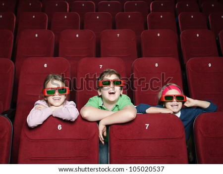 Laughing kids watching a movie