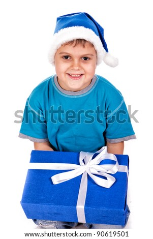 Laughing little boy in Santa's hat with gift boxes isolated on white