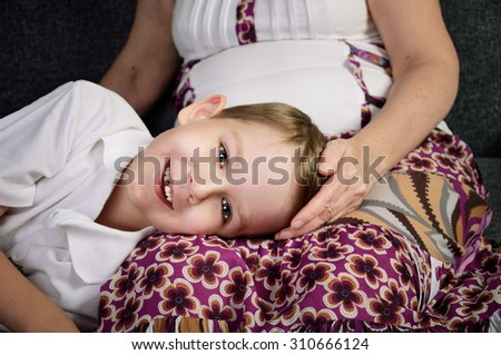 laughing little boy looking at camera and his loving grandmother. horizontal - stock photo
