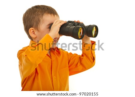 Laughing little boy looking through binocular isolated on white background