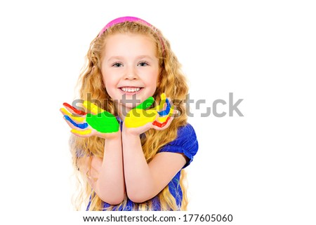 Laughing little girl painted in bright colors. Happy childhood. Isolated over white. - stock photo