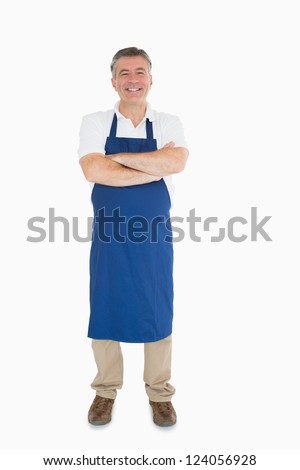 Laughing man dressed in blue apron