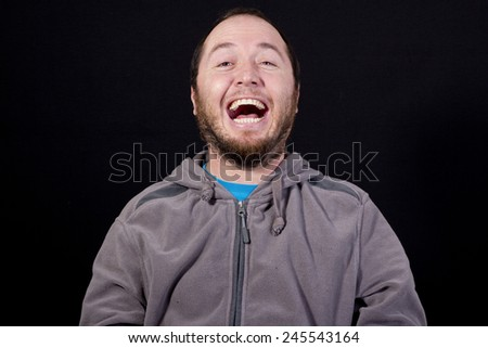 laughing man isolated black background