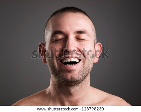 Laughing man isolated on black background. - stock photo
