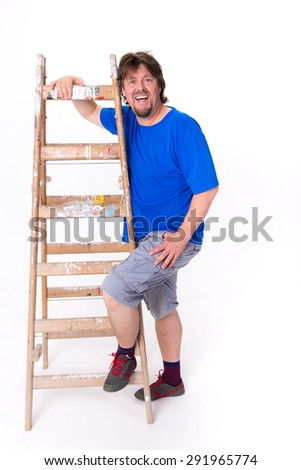 Laughing man standing next to a ladder isolated on a white background